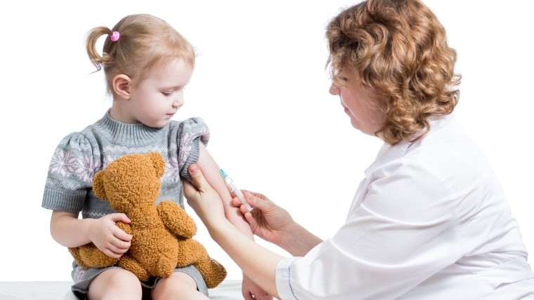 doctor vaccinating kid isolated on a white